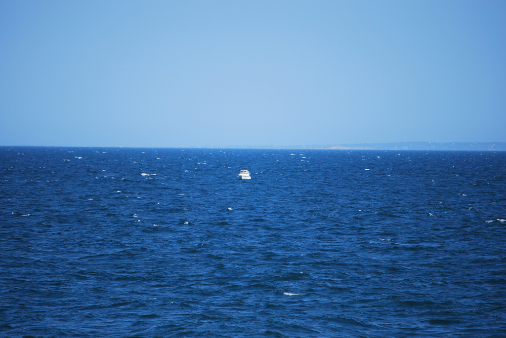 Small boat on large sea
